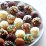 Plate full of dark, milk and white chocolate truffles