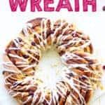 Overhead of cinnamon roll wreath with vanilla glaze with text overlay