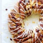 Overhead of cinnamon roll wreath with vanilla glaze