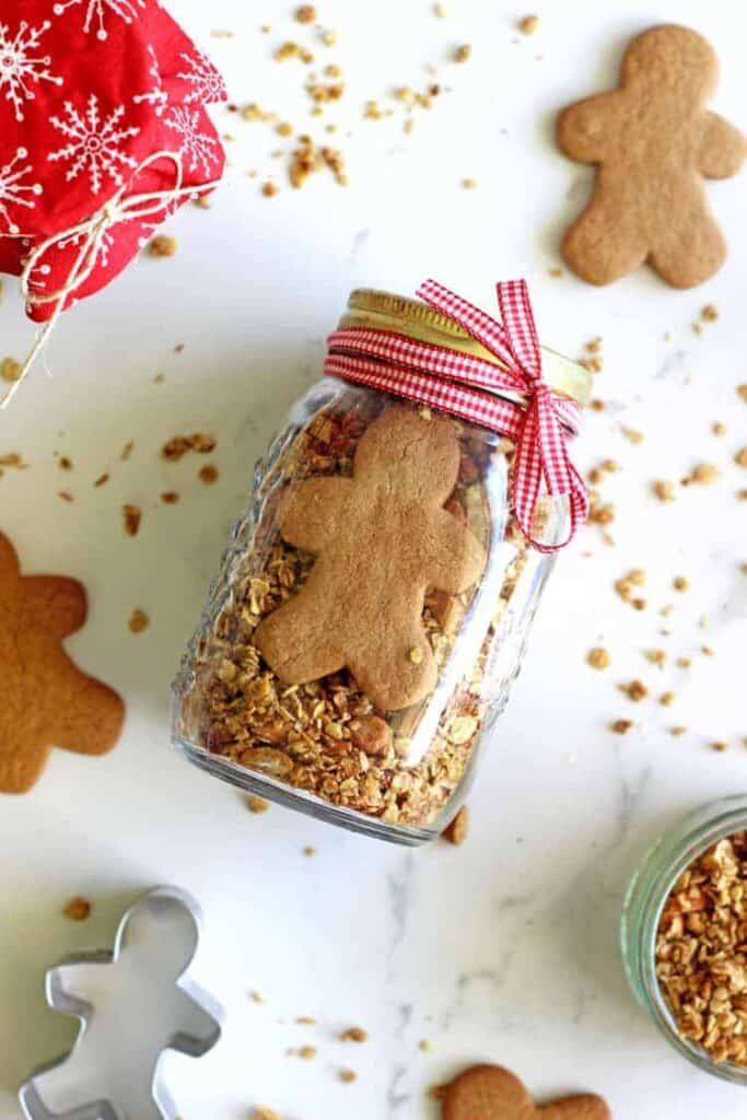 Jar with gingerbread granola with a gingerbread man inside
