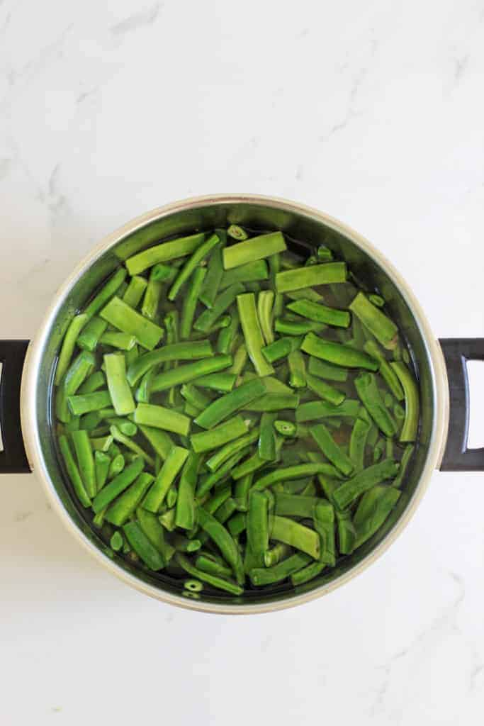 Large pot of green beans being blanched