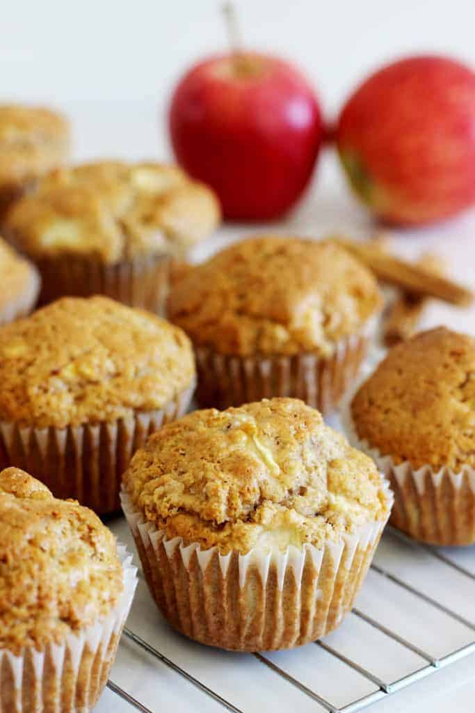 Spiced apple muffins on a metal cooling rack