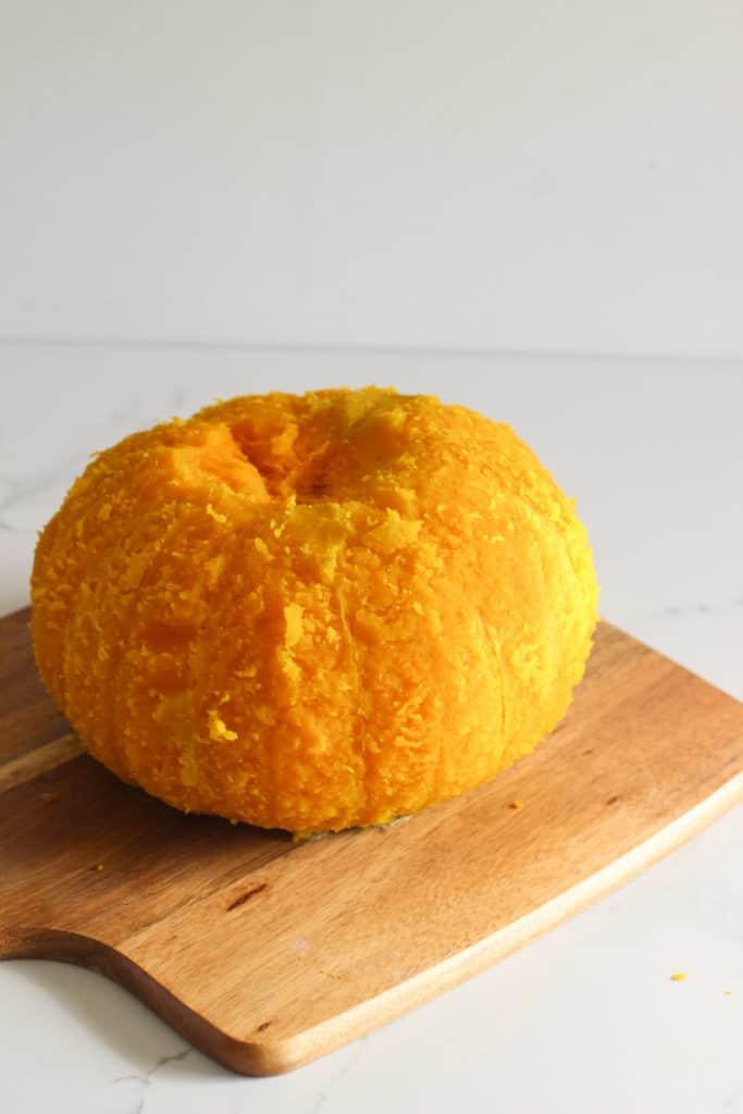 Peeled pumpkin on chopping board