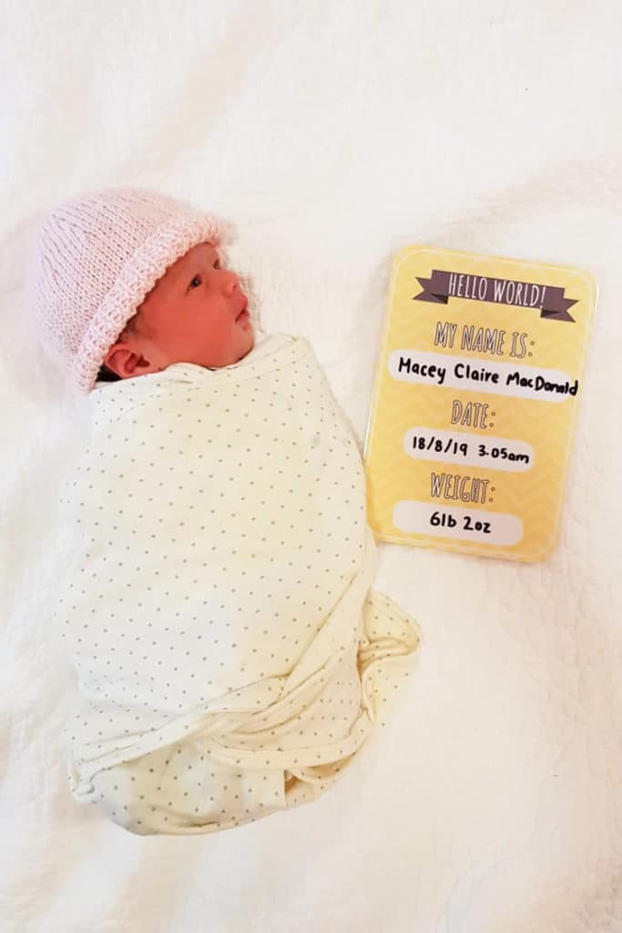 Baby Macey with birth announcement card