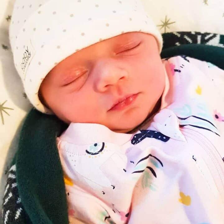 Newborn baby Macey in pink onesie