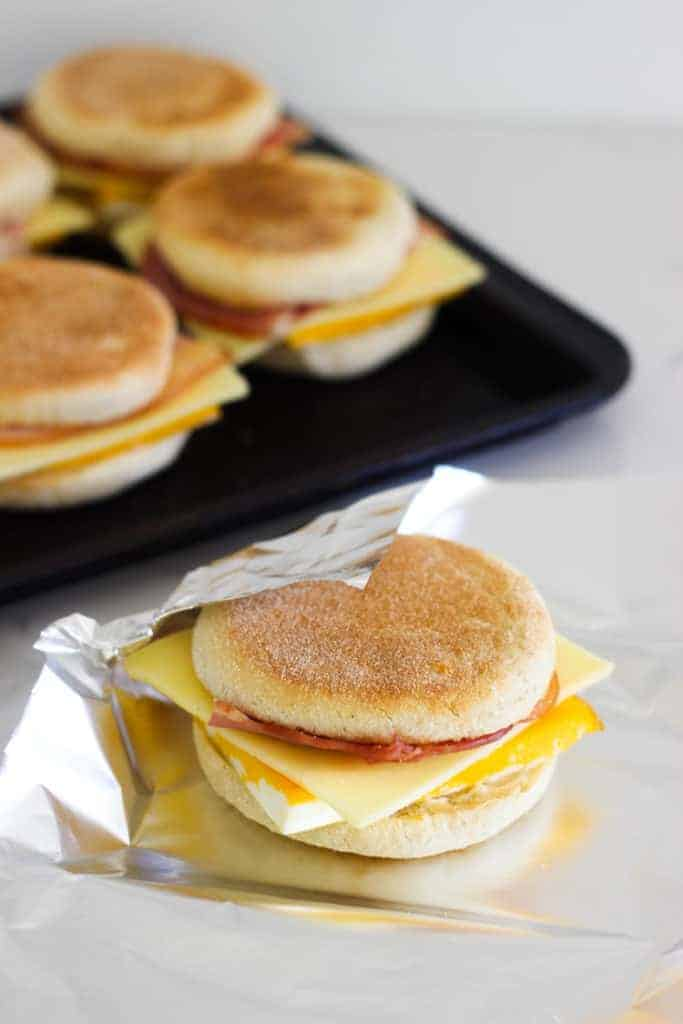 Bacon and egg freezer mcmuffin being wrapped in tinfoil