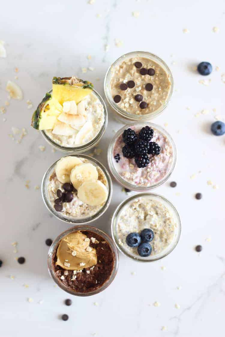 6 jars of overnight oats on a white background