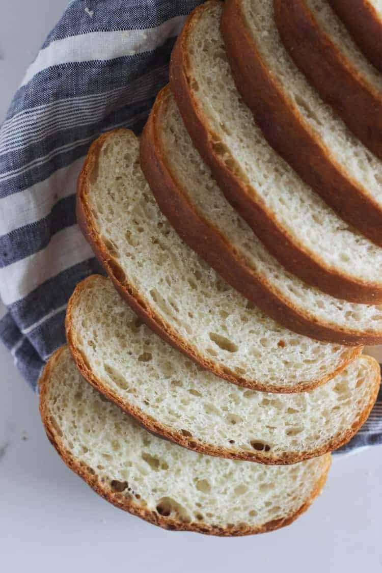 Sliced loaf of homemade white sandwich bread
