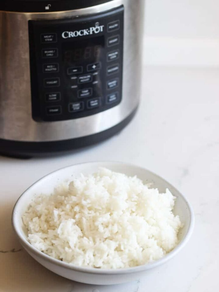 White rice in a bowl with Crock Pot Multi cooker
