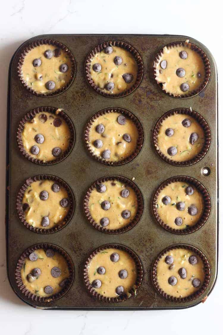 Zucchini muffin batter in tins