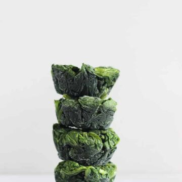 Stack of frozen spinach cups