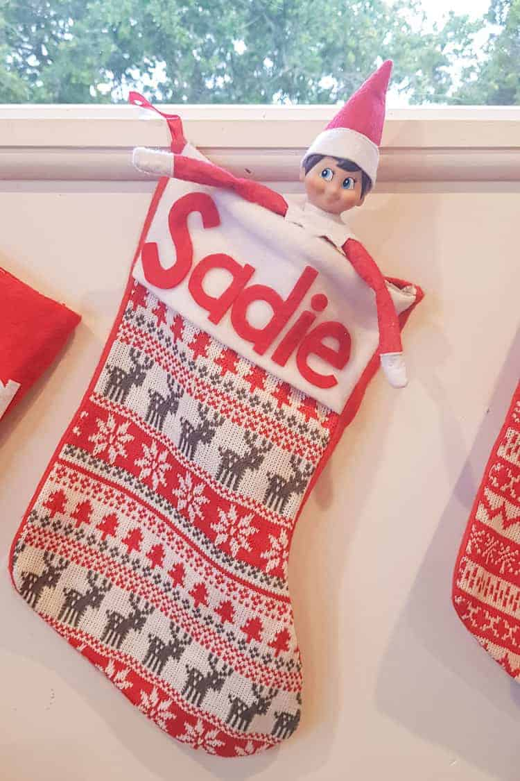 Elf on the shelf in a Christmas stocking