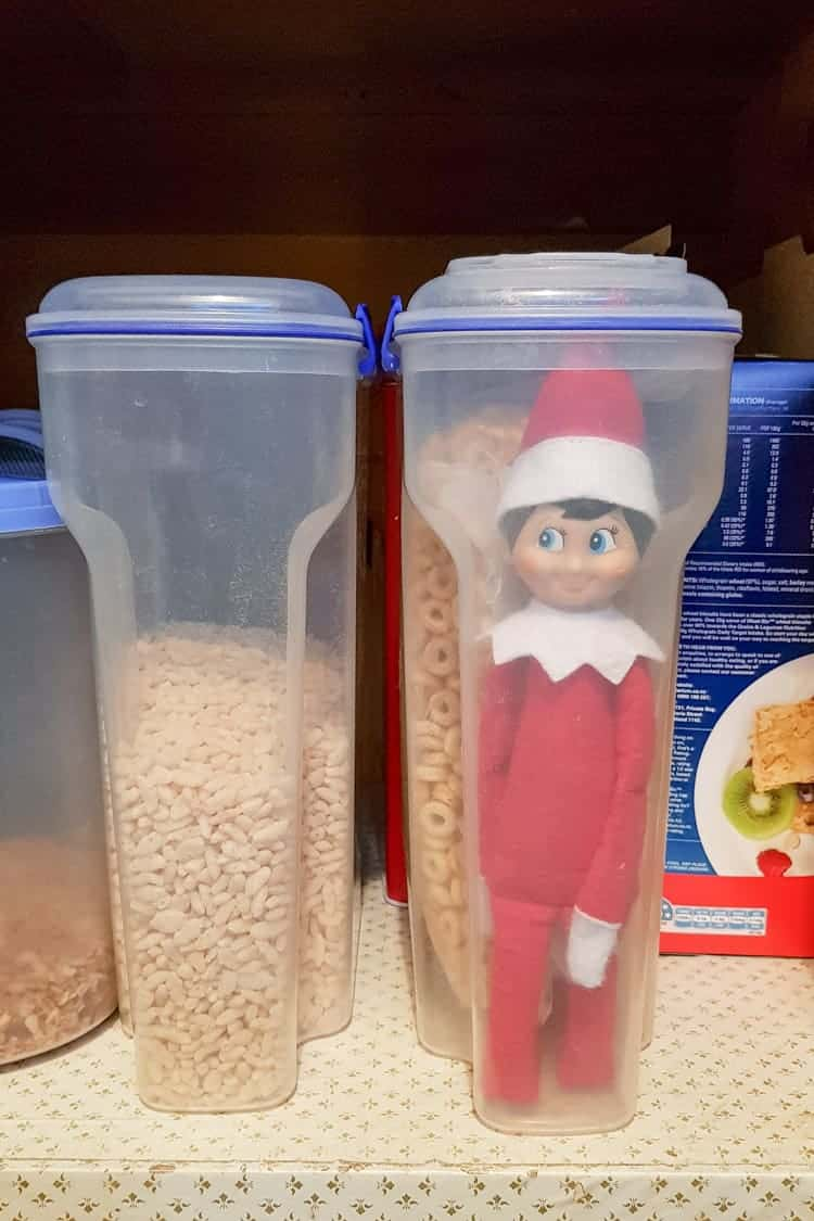 Elf on the shelf trapped in a cereal box