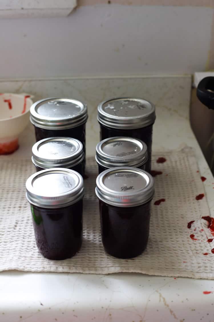 Full jars of strawberry jam