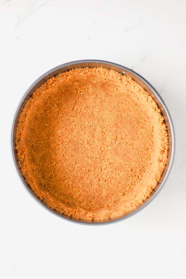 Gingernut biscuit cheesecake base in cake tin